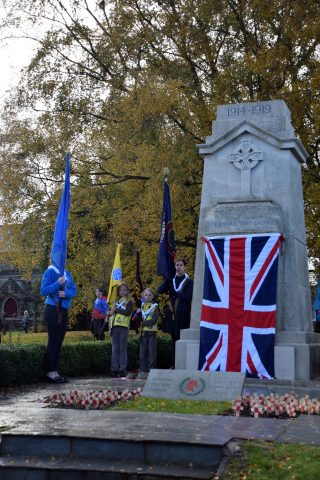 War memorial and flag bearers on Remembrance service 2019