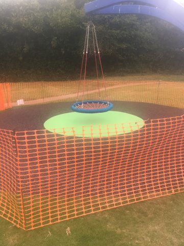 Photo of new safety surface under the basket swing in the recreation ground