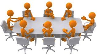 people around a meeting table